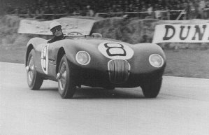 Stirling Moss racing at Le Mans in Grenfell racing suit